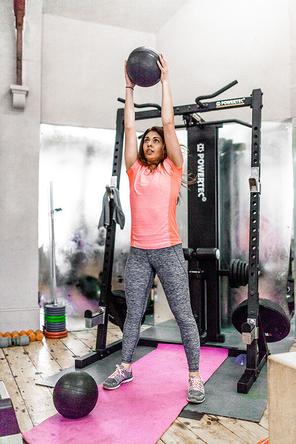 woman performing slam balls at ems fitness norwich