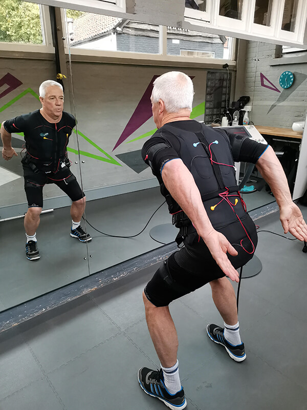 an older man undertaking ems session