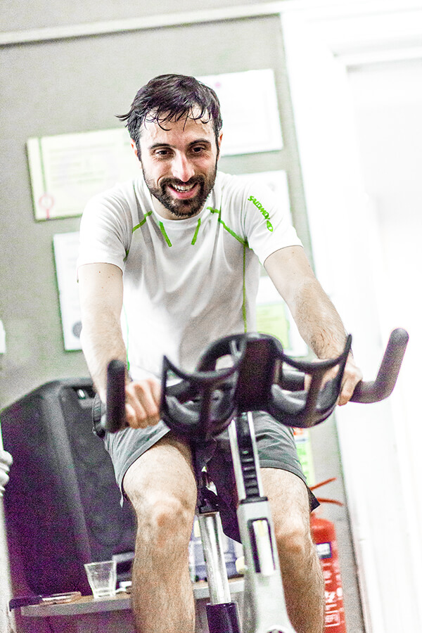 a man is sweating from his training on an exercise bike
